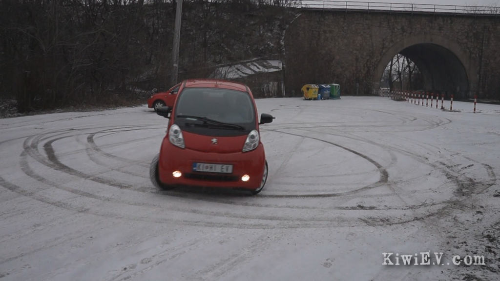 doing donuts electric car snow