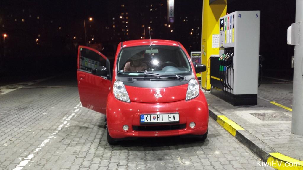 an electric car buying gas