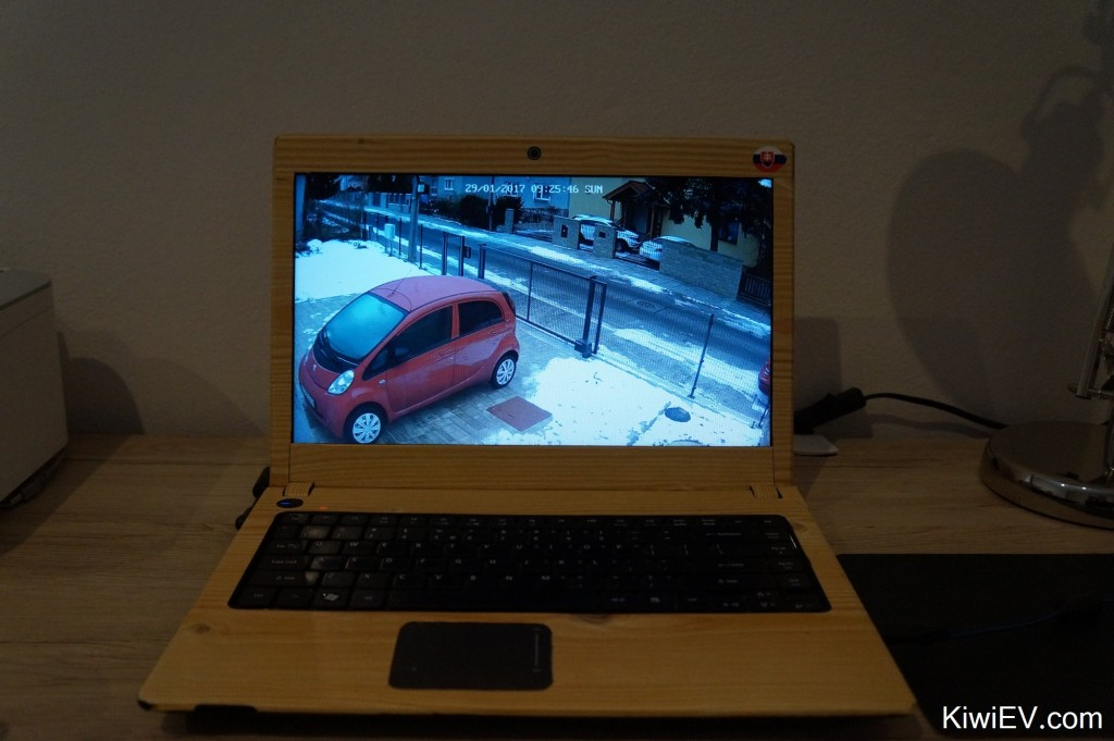 Watching the car on the security camera.