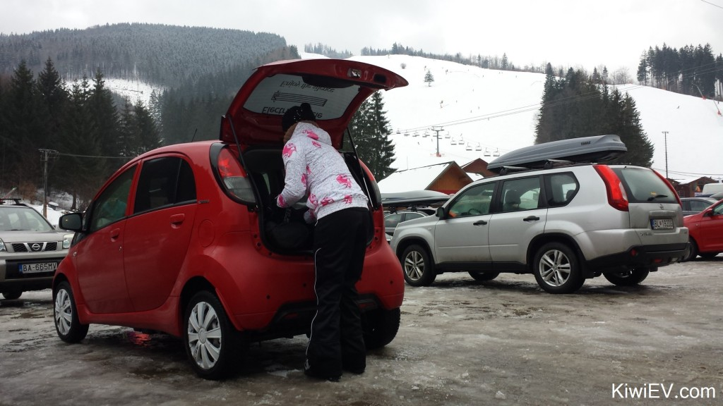 Taking the electric car skiing in the mountains