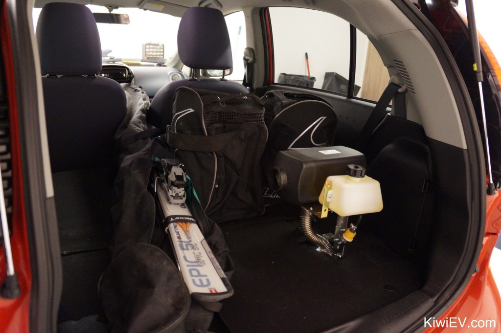 skis inside the electric car